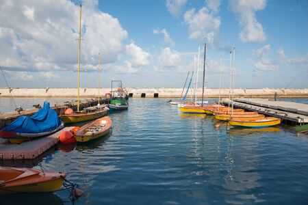 jafo: TEL AVIV, ISRAEL - MARCH 2, 2015: The little harbor and yachts under old Jaffa  in the morning light and a man at fishing.