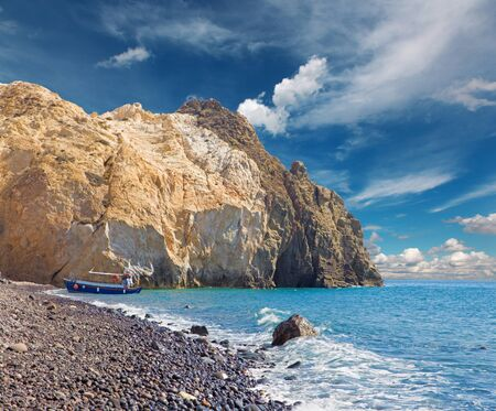 SANTORINI, GREECE - OCTOBER 7, 2015: The Black beach from south part of the island. Editorial