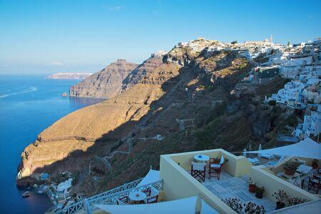fira: SANTORINI, GREECE - OCTOBER 6, 2015: The Fira in morning light and the Firostefani Editorial
