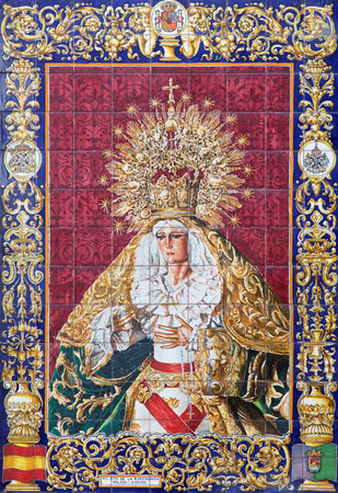 cried: JERUSALEM, ISRAEL - MARCH 4, 2015: The ceramic tiled, cried Madonna from Malaga on the facade of house near the Flagellation church by unknown artist of 20. cent.