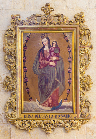 polychrome: CORDOBA, SPAIN - MAY 26, 2015: The Madonna of Rosary painting in carved polychrome frame in church Iglesia de San Augustin by unknown baroque artist.