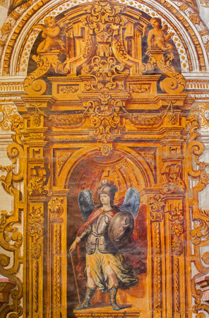 panoply: GRANADA, SPAIN - MAY 29, 2015: The baroque fresco of angel with the staff and shield in nave of church Monasterio de San Jeronimo by Juan de Medina from 18.cent.