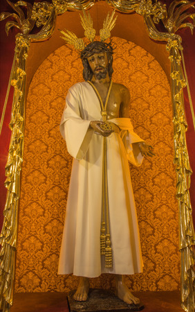 typically: CORDOBA, SPAIN - MAY 27, 2015: The typically statue of vested (Jesus Christ Nuestro Padre de la Humildad) by Antonio Bernal (1997) in church Convento de Capuchinos (Iglesia Santo Angel).