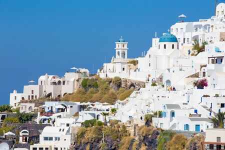 greece: SANTORINI, GREECE - OCTOBER 7, 2015: The outlook over the Imerovigili to caldera with the Therasia island in the background.