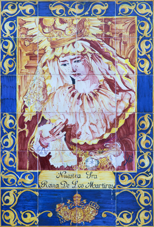 cried: CORDOBA, SPAIN - MAY 26, 2015: The ceramic tiled, cried Madonna on the facade of church Iglesia de San Hipolito by artist Blanca Augilar Garcia from year 1994.