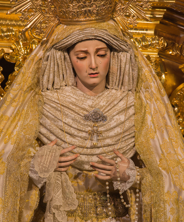 cried: MALAGA, SPAIN - MAY 31, 2015: The traditional vested statue of cried Virgin Mary in church Iglesia del Santiago Apostol by unknown artist. Editorial