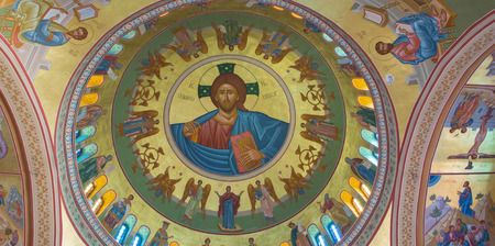 christ: SANTORINI, GREECE - OCTOBER 7, 2015: The fresco of Christ the Pantokrator local artist Christoforos Asimis (20. cent.) on the cupola of The Orthodox Metropolitan Cathedral in Fira.