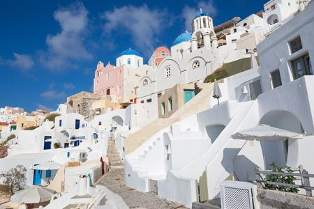 typically: Santorini - The look to typically blue churches cupolas in Oia with the white house stairs.