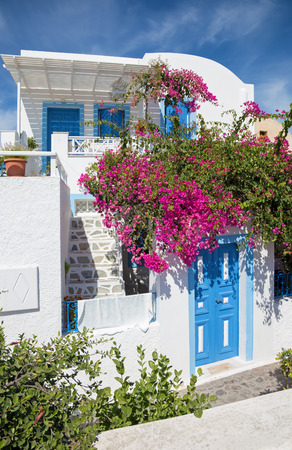 typically: Santorini - The typically little house and yard with he flowers in Oia.