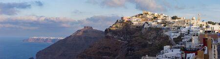 firostefani: SANTORINI, GREECE - OCTOBER 5, 2015: The Fira at morning dusk and the Firostefani Editorial