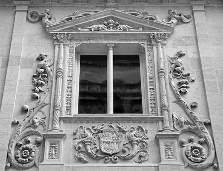 nobles: GRANADA, SPAIN - MAY 29, 2015: Detail from renaissance-baroque portal of Colegio de Ninas Nobles by Juan de Marquina (16. cent.)