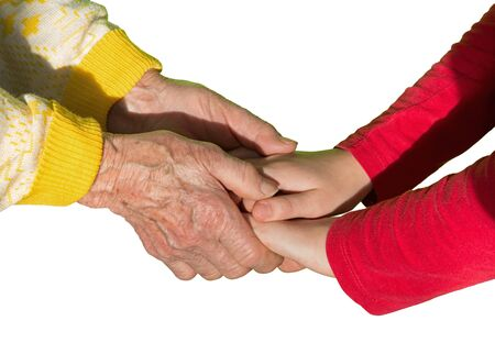 senescence: The isolated hands of grandmother and grandchild