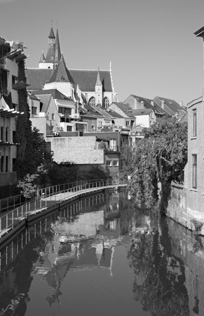 benelux: Canal and Church of Our Lady across the Dyle in background Stock Photo