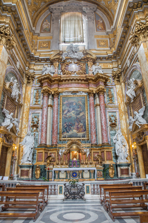worshipped: ROME, ITALY - MARCH 25, 2015: Side altar of baroque church Basilica dei Santi Ambrogio e Carlo al Corso with the altarpiece God the Father Being Worshipped by Angels by Tommaso Luini (1601 – 1636) Editorial