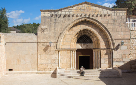 mount of olives: JERUSALEM, ISRAEL - MARCH 3, 2015: The orthodox church Tomb of the Virgin Mary under the Mount of Olives and the beggar.