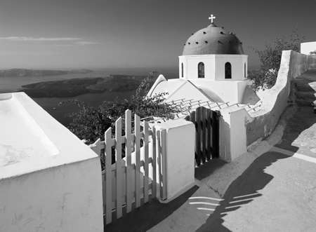 typically: Santorini - The look to typically church cupolas in Imerovigli over the caldera in background. Stock Photo