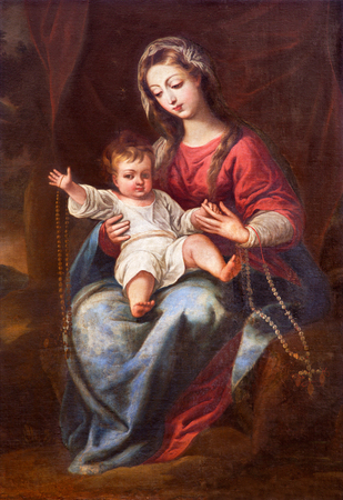 GRANADA, SPAIN - MAY 31, 2015: The Madonna (The Virgin of the Rosary) painting in church Monasterio de la Cartuja by unknown artist of 18. cent.