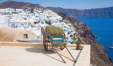 pushcart: Santorini - The decoriative push-cart in Oia. Stock Photo