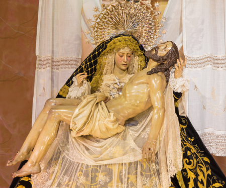 vested: CORDOBA, SPAIN - MAY 26, 2015: The traditional vested Lady of Sorrow statue (Pieta) in church Iglesia de San Augustin from 19. cent.