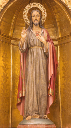 polychrome: CORDOBA, SPAIN - MAY 27, 2015: The carved polychrome statue of Heart of Jesus by unknown artist cca. 1780  in church Iglesia de San Juan y Todos los Santos. Editorial