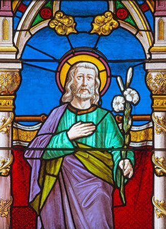 windowpane: BANSKA BELA, SLOVAKIA - FEBRUARY 5, 2015: The St. Joseph on the windowpane of St. John the Evangelist church from end of 19. cent.
