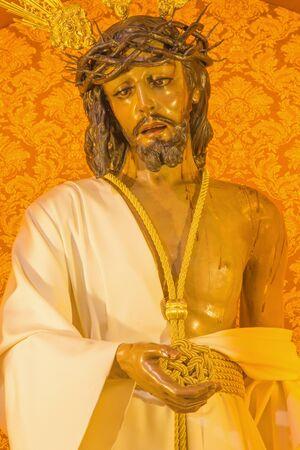 vested: CORDOBA, SPAIN - MAY 27, 2015: The typically statue of vestet (Jesus Christ Nuestro Padre de la Humildad) by Antonio Bernal (1997) in church Convento de Capuchinos (Iglesia Santo Angel).