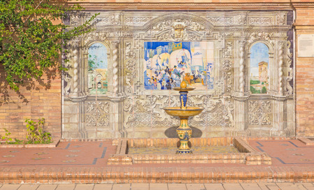 festal: SEVILLE, SPAIN - OCTOBER 28, 2014: The one part of The tiled Province Alcoves along the walls of the Plaza de Espana (1920s) realized by Domingo Prida. Festal procession in Sevilla.