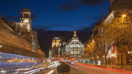 cibeles: MADRID, SPAIN - MARCH 9, 2013:  Look from Plaza de Cibeles to Cale de Alcala street and Metropolis building in dusk.