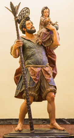 cristobal: SEVILLE, SPAIN - OCTOBER 28, 2014: The statue of st. Christopher (Cristobal) on side altar form years 1732 - 1734 in baroque Church of El Salvador (Iglesia del Salvador) by Jose Maestre. Editorial
