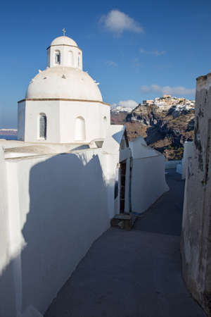 outlook: Santorini - The outlook from little church in Fira to Firostefani and Imerovigli in morning light.