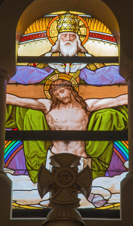 windowpane: VIENNA, AUSTRIA - FEBRUARY 17, 2014: Jesus on the cross and God the Father from windowpane in Carmelites church in Dobling by Geyling workroom from the beginning of the 20. cent.