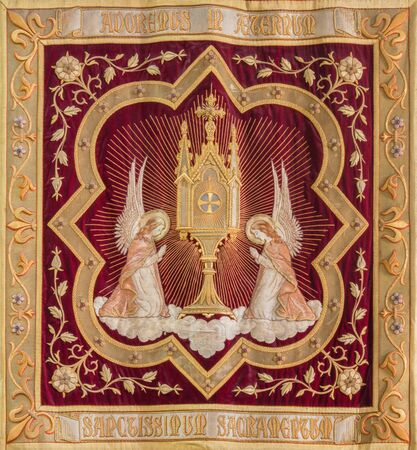 adoration: MECHELEN, BELGIUM - SEPTEMBER 4,2013 : Needlework of the Eucharist adoration of angels from Onze-Lieve-Vrouw-va n-Hanswijkbasiliek church. Editorial
