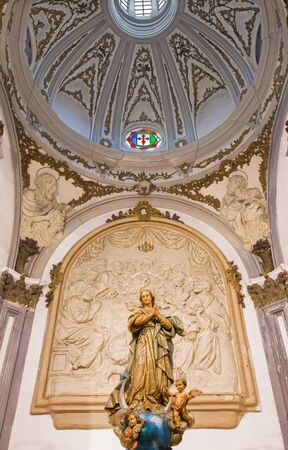 polychrome: MALAGA, SPAIN - MAY 31, 2015: The carved and polychrome Immaculate Conception statue in church Iglesia del Santiago Apostol by unknown artist of 20. cent. from Valencia. Editorial