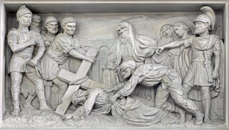 church of our lady: MECHELEN, BELGIUM - JUNE 14, 2014: Stone relief Jesus fall under cross in church Our Lady across de Dyle by P. J de Cuyper.