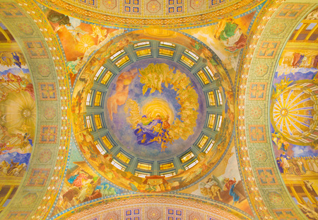 salesian: ROME, ITALY - MARCH 10, 2016: The main cupola with the Assumption fresco (1957-1965)  in main apse of church Basilica di Santa Maria Ausiliatrice by the Salesian priest and artist Don Giuseppe Melle.