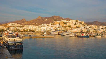 naxos: CHORA, GREECE - OCTOBER 6, 2015: The town Chora (Hora) on the Naxos island at evening light in the Aegean Sea.