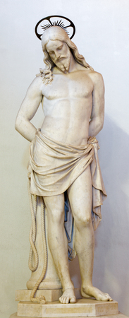 flagellation: ROME, ITALY - MARCH 11, 2016: The marble statue of Christ Tied to the Column of Flagellation by Giosue Meli (1816 - 1893). The vestibule of church Chiesa di San Lorenzo in Palatio ad Sancta Sanctorum. Editorial