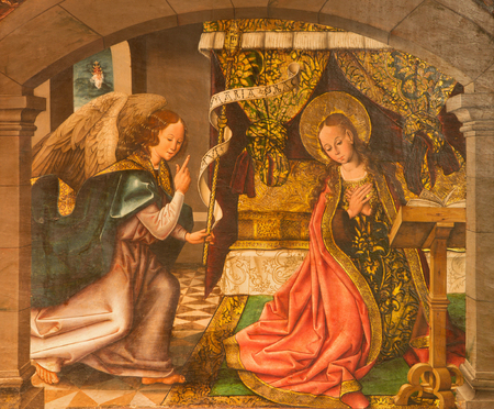 angel gabriel: AVILA, SPAIN, APRIL - 18, 2016: The Annunciation painting on the wood in Catedral de Cristo Salvador in Capilla del Cardenal by Maestro de Riofrio from 16. cent.