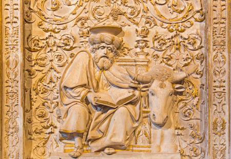 evangelist: AVILA, SPAIN, APRIL - 18, 2016: The relief of St. Luke the Evangelist in Girola of Catedral de Cristo Salvador. Stock Photo