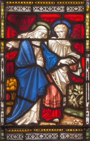 workroom: ROME, ITALY - MARCH 9. 2016: The St. John and Virgin Mary on the windowpane of All Saints Anglican Church by workroom Clayton and Hall (19. cent.)