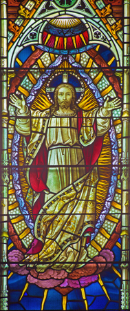 windowpane: ROME, ITALY - MARCH 9. 2016: The Resurrected Lrod as the part of  Ascension of the Lord scene on the windowpane of All Saints Anglican Church by workroom Clayton and Hall (19. cent.)