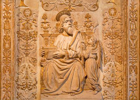 evangelist: AVILA, SPAIN, APRIL - 18, 2016: The relief of St. Matthew the Evangelist in Girola of Catedral de Cristo Salvador.