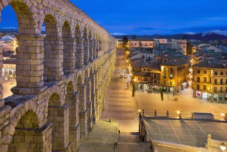 segovia: SEGOVIA, SPAIN, APRIL - 13, 2016: Aqueduct of Segovia and Plaza del Azoguejo at dusk. Editorial