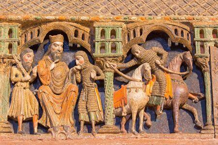polychrome: AVILA, SPAIN, APRIL - 19, 2016: Detail of reliefs from life of saints on the romanesque polychrome funeral memorial Cenotafio de los Santos Hermanos Martires church Basilica de San Vicente (12. cent.)