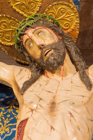 affiliation: AVILA, SPAIN, APRIL - 19, 2016: Crucifixion in church of Real monasterio de Santo Tomas from 16. cent.  in chapel Capilla del Cristo de la Agonia (St. Theresia often prayed in front of this Christ). Editorial