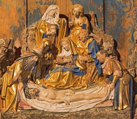 polychrome: SEGOVIA, SPAIN, APRIL - 14, 2016: The polychrome baroque relief of Burial of Jesus in atrium of church Monasterio de San Antonio el Real from 15. cent. Editorial
