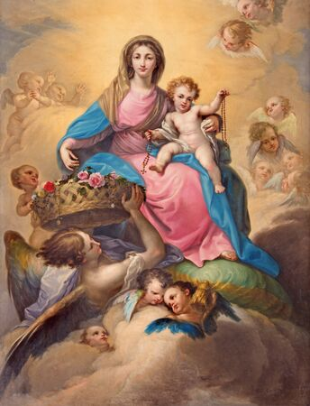 SEGOVIA, SPAIN, APRIL - 14, 2016: The painting Madonna with the Child among the angels by Don Ramon Bayeu (1789)  in Cathedral of Our Lady of Assumption and Chapel Our Lady of Rosary. Редакционное