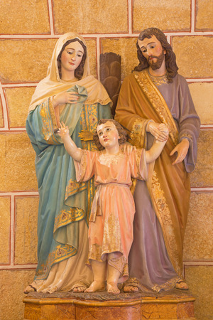 family church: AVILA, SPAIN, APRIL - 19, 2016: The sculpture of Holy Famili in Basilica de San Vicente church by unknown artist 19. cent.