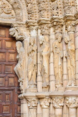 avila: AVILA, SPAIN, APRIL - 19, 2016: The right part of romanesque west portal of Basilica de San Vicente with the apostles. (1130). Editorial