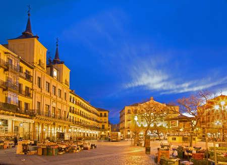 SEGOVIA, SPAIN, APRIL - 14, 2016: The Plaza Mayor square and the morning market Editorial